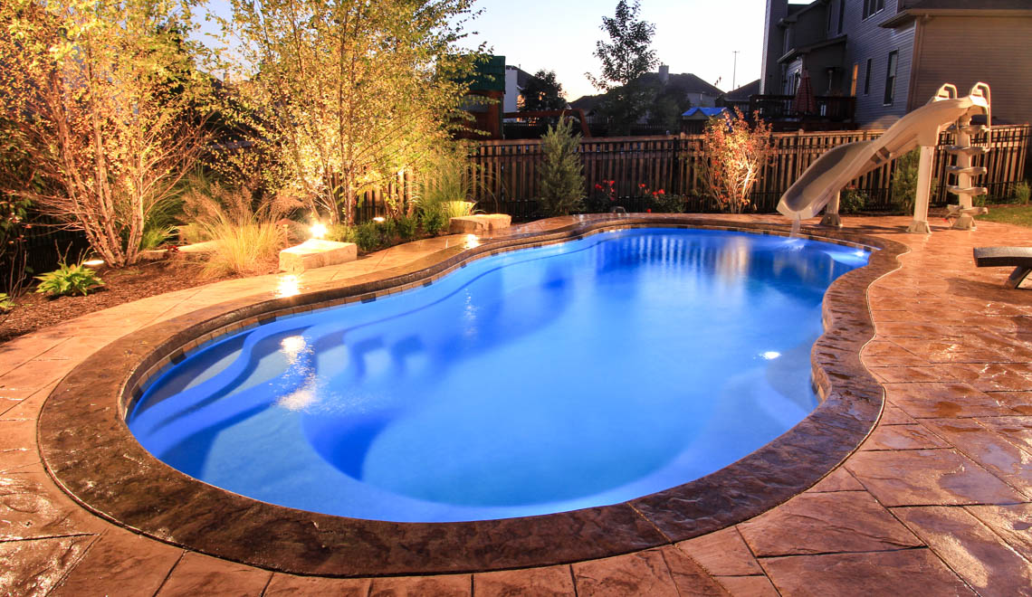 Leisure Pools Riviera large composite freeform swimming pool with deep end swimout