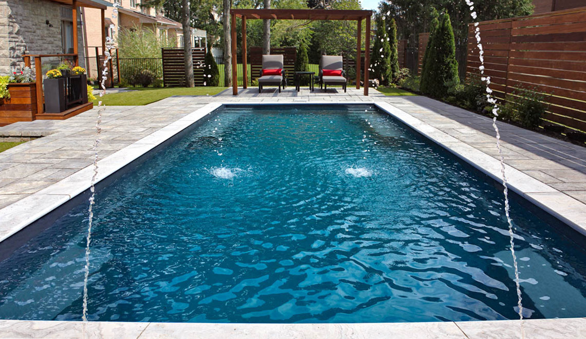 Leisure Pools Supreme composite in-ground swimming pool with deep end swimout and bench seats