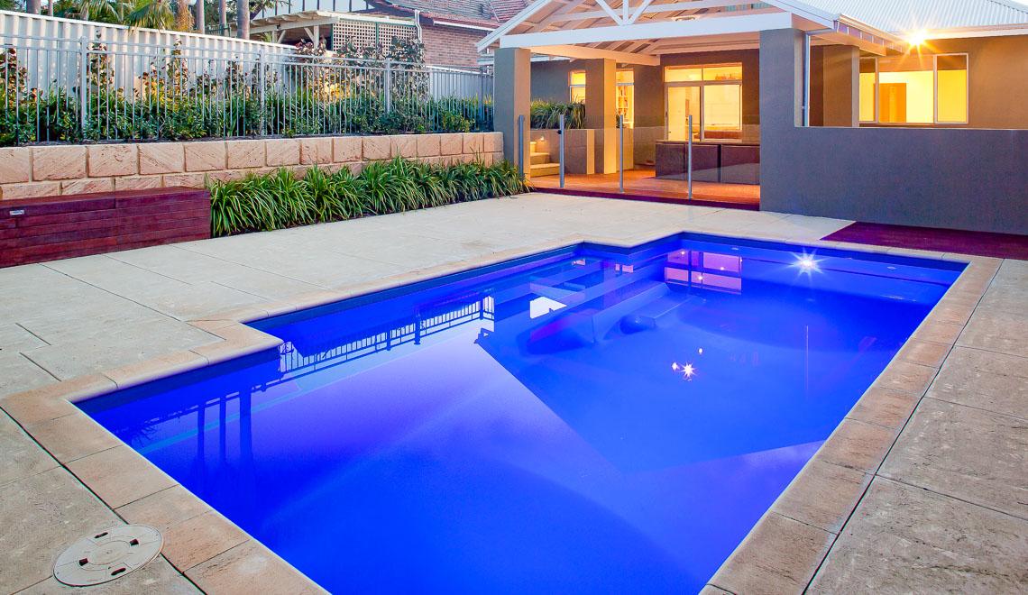 Leisure Pools Elegance fiberglass swimming pool with perimeter safety ledge