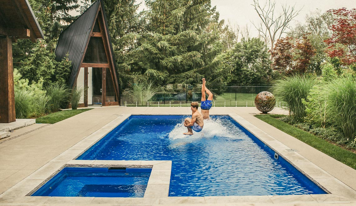 Leisure Pools Icon fiberglass diving pool with built-in spa and splash deck