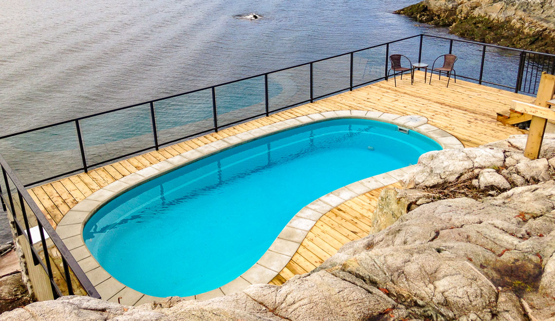 Leisure Pools Tuscany freeform composite swimming pool with deep end seat and swimout