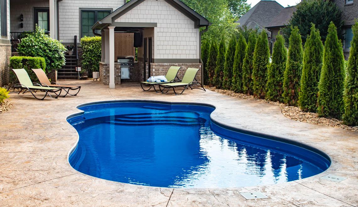 Leisure Pools Eclipse composite fiberglass swimming pool with built-in splash deck