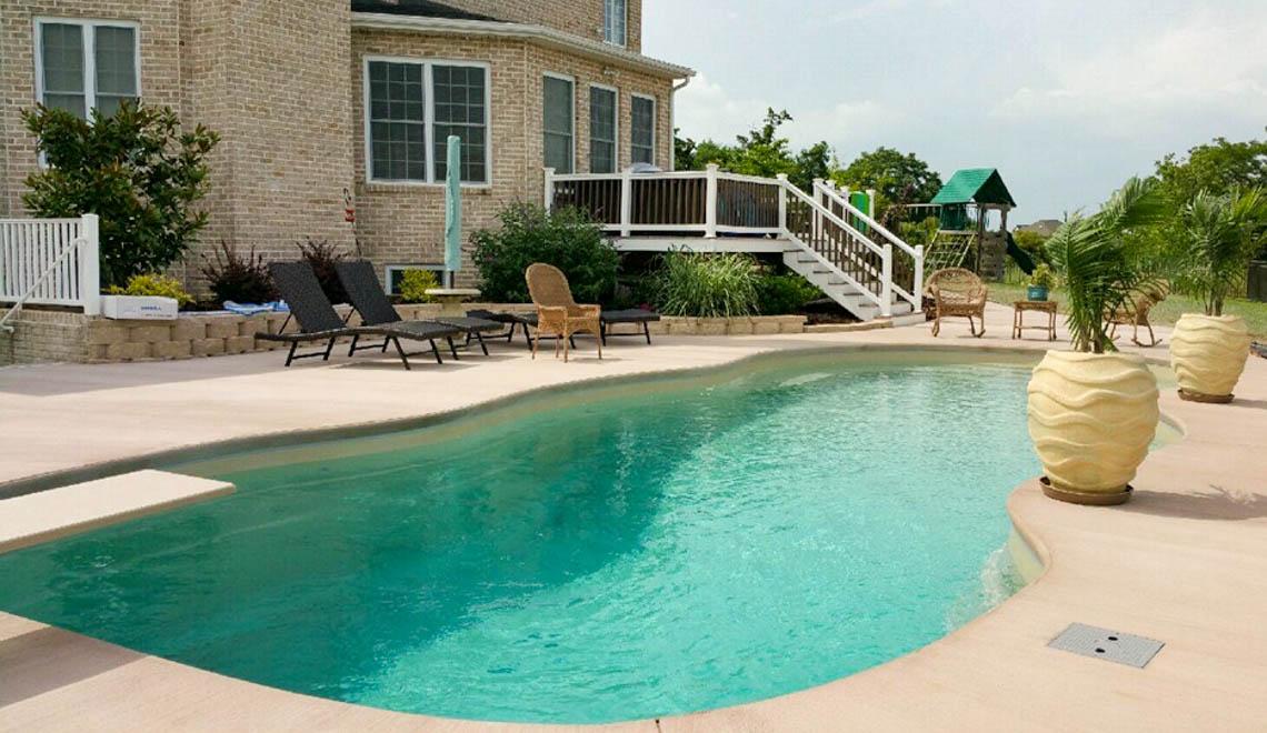 Leisure Pools Mediterranean fiberglass freeform swimming pool with unobstructed swimming corridor