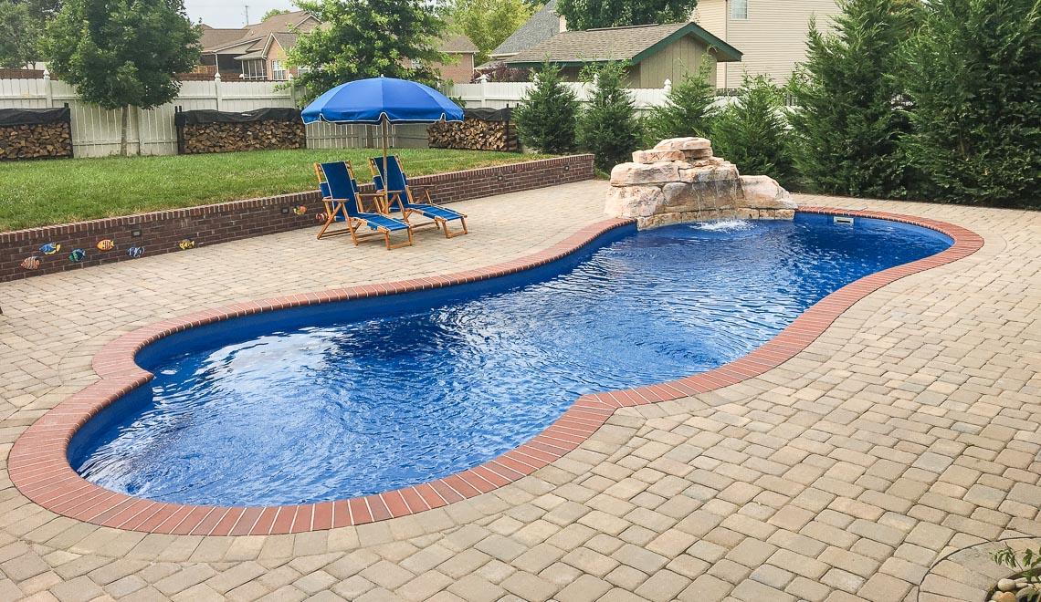 Leisure Pools Eclipse freeform fiberglass swimming pool